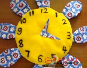 幼儿园废旧物手工制作:向日葵时钟(一物多玩)